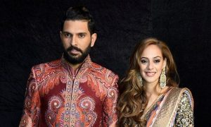 New Delhi:  Cricketer Yuvraj Singh and his wife Hazel Keech pose for a photograph during their reception party in New Delhi on Wednesday. PTI Photo (PTI12_7_2016_000335B)