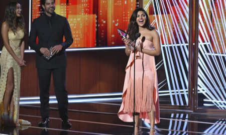 Jamie Chung and Adam Rodriguez look on from left as Priyanka Chopra accepts the award for favorite TV drama actress at the People's Choice Awards at the Microsoft Theater on Wednesday, Jan. 18, 2017, in Los Angeles. (Photo by Vince Bucci/Invision/AP)